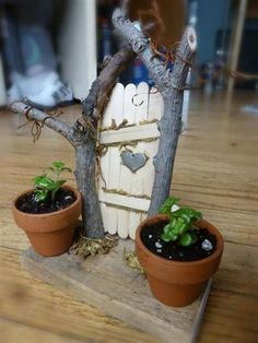 Totally adorable.. you can easily make this with Popsicle sticks, twigs and little itty bitty clay pots! Have fun :)  ~Tumblr