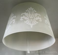 stenciled jara lamp shade from ikea (inside flips so you can hang from the ceiling or a lamp) from not just a housewife