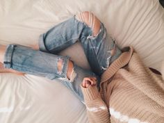 ripped jeans and oversized sweater