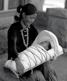 Navajo Mother with Baby in a Cradleboard.  Still used today, I used this for my daughter for her naps,  the designs for the string part has changed though.