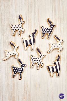 Trendy tones of black and white in distinctive graphic designs make these reindeer cookies the talk of your cookie treat table at your holiday party! Use the Wilton Deer Cookie Cutter Set to cut the shapes, cover the cookies in Color Flow icing, and then draw and fill in the designs using the Wilton FoodWriter edible color marker.