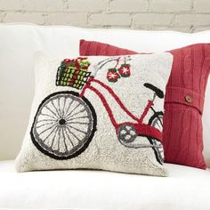 Special Delivery Hooked Pillow | This charming hooked pillow cultivates the feel of a cozy, small-town holiday with the help of a vintage-style bicycle, knit mittens, and wrapped presents.