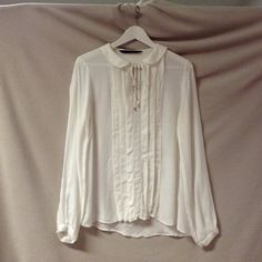 Zara Basic cream sheer top In excellent condition super cute cream blouse with a thin collar. Ties at the neck. Tuxedo inspired front. Buttons at the wrist. It's an xs but fits me perfectly and I'm a S/M Zara Tops Blouses