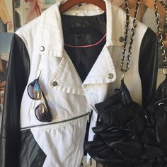 Moto Jacket! White denim and black faux leather Steve Madden has put a super cool vibe into this Moto Jacket!! White denim, black faux leather, pink interior piping and zipper detailing. Asymmetrical front zip close. NWOT. Steve Madden Jackets & Coats Jean Jackets