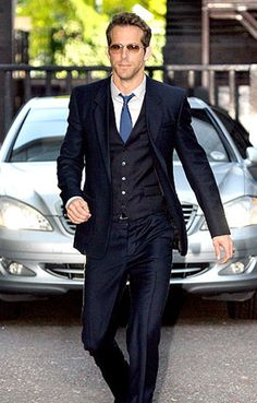 Another guy to take style tips from is Ryan Reynolds! Love this 3 piece navy blue tailored suit!