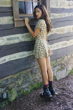 90 's style Sunflowers / boots. I don't know why but I just love the idea of pretty dresses with those edgy boots..