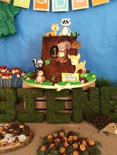 Fun cake and treats at a woodland forest birthday party! See more party planning ideas at CatchMyParty.com!