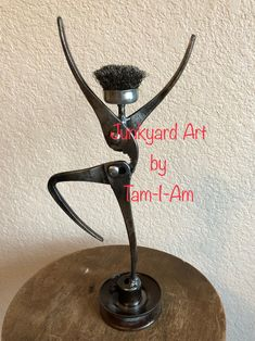Junkyard Art by Tam-I-Am. Two pair of pliers and a small wire brush make up this happy dancer...or cheerleader. Take your pick. Repurposed tools. Scrap metal art.