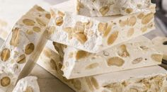 Torrone is a very simple nougat candy made from egg whites, honey, nuts (usually almonds) and –in some recipes– cane sugar. The recipes of several popular commercial candy bars (Toblerone, Mars, etc. Italian Cookie Recipes, Italian Cookies, Italian Foods, Authentic Italian Desserts, Italian Biscuits, Candy Recipes, Dessert Recipes, Dinner Recipes, Italian Candy