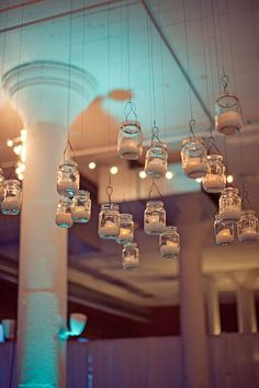 Mason jars hanging from the ceiling - amazing.