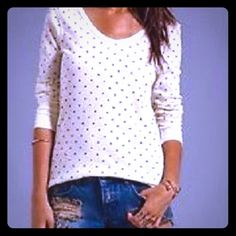 New• FREE PEOPLE Vanilla Polka Dot Stretch Henley• Love this! Such a fun and unusual top! Authentic and brand new without tags, We The Free by Free People in women's size Medium. Ivory Vanilla Combo Polka Dot Waffle Pointelle Thermal. The perfect layering tee and looks adorable with your favorite capris! Heathered dots lends a smattering of whimsy to a finely textured stretch-thermal top. Can fit a medium or large beautifully!  Cotton/polyester; machine wash. By Free People; Made in the USA…