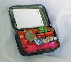 """""""Altoids Anti-Boredom Kit, contains Inside: -Tiny deck of cards -Small vial of touchable bubbles -Two tubes of plastic bubbles -Tiny colored pencils -Note pad -String for cats cradle -Quarter to vend treats (a dollar fits nicely too for bigger treats) -Balloon (for playing don't touch the ground or keep away)"""""""