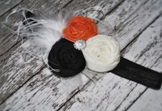 This beautiful and cheery headband is sure to make you smile! SALE! SALE ! SALE!... originally $22.99Created from only the finest fabrics and silks in orange, black and ivory. Embellished rosettes, delicate ruffle lace, pearl, and ostrich feathers are attached and felt backed for head protection on a elastic headband. Must specify if clip is desired!!!Please specify on sizing. Infant, toddler, child or adult. Please do not copy. 2013 J'Lexi Jolie Couture Original!!!Fol...