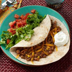 "Chuck Wagon Wraps Recipe -If you like baked beans, you'll savor this robust wrap. Wendy Conger of Winfield, Illinois combines canned baked beans, ground beef and corn, then rolls it up in tortillas. ""I was wondering what to fix for dinner one night and came up with this,"" Wendy writes. My husband raved about it! It's fast and easy to make, too."""