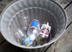 Instead of putting rocks in the bottom of big porch planters, she fills the bottom with sealed empty plastic 20 ounce bottles! They give the pot the drainage it needs, without adding all that extra weight.