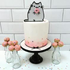 A special @pusheen inspired donut cake and pops