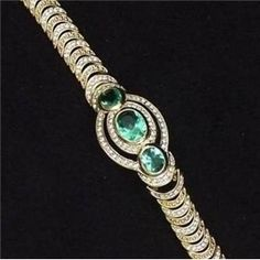Jackie lit up the room when she wore her classic emerald bracelet set with 3 cabochon emeralds and 180 diamonds. It was a gift from JFK.