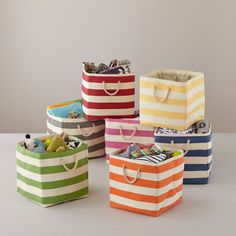 Shop Striped Cube Floor Bins.  Clutter around the house? Try our Stripes Around the Floor Bins.  They're available in five different colors and even have natural rope handles so you can move them around and match your décor.
