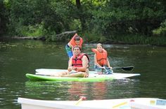 Standup paddle boarding is a fun and challenging activity our campers love on the lake!