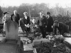 Lady Churchill and family lay a wreath on the grave of Sir Winston Churchill, Bladon, Oxfordshire, England (1974). Consuelo Vanderbilt and her son Lord Ivor Churchill are interred nearby.