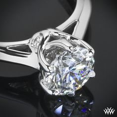 """Vatche designs superb craftsmanship is on full display with the """"Swan"""" Solitaire Engagement Ring by Vatche. This 6 prong beauty incorporates an open cathedral style shank with four surprise diamonds nestled within the gallery of the head for that extra little sparkle."""