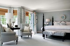 Styled by StacyStyle for @New England Home. Photo by Sam Gray. Blue and white master bedroom.