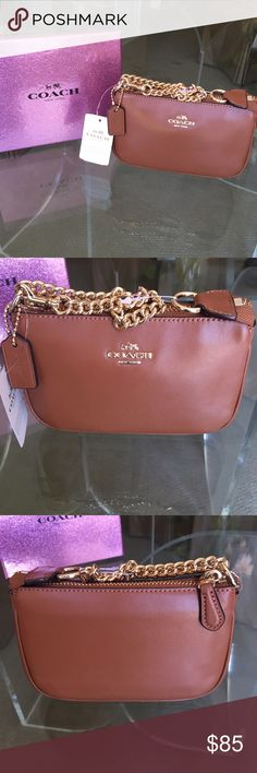 "Brand NWT Coach Saddle Brown Wristlet W/Gold Chain Beautiful and super cute brand new with tags Coach wristlet! Buttery soft saddle brown leather, gold dog leash chain that can be worn two ways, signature coach gold emblem on front, zip closure. Measures 6.25"" across and 4"" high. Such a classy and stylish little purse! Perfect for running around town or taking on your summer travels! In impeccable condition!❤️ Coach Bags Clutches & Wristlets"