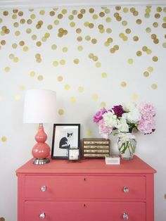 A gold DIY stenciled accent wall using the Polka Dot 6 piece stencil kit from Cutting Edge Stencils. http://www.cuttingedgestencils.com/polka-dot-stencils-circle-stencil.html