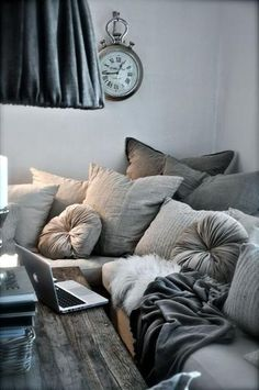 There is no such thing as too many pillows. Okay, there probably is, but pillows and blankets are the staples of comfort. For maximum coziness, make your home feel like an adult version of the pillow forts you used to build as a kid. Try turning old sweaters into pillows and mix and match with different blankets. (Photo: Carla Aston)