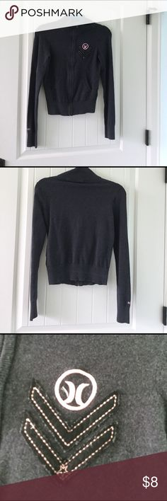 """Women's Hurley jacket This is a grey women's Hurley jacket. It had the Hurley symbol with some arrows on the left side and it says """"Hurley"""" on the right arm sleeve. Been worn quite a bit. Hurley Jackets & Coats"""