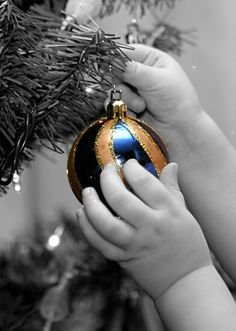 Sweet toddler hands hanging Christmas ornament