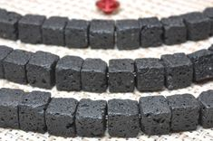 57 pcs of Natural Black Lava square matte cube beads in 6.5-7mm(07036#)