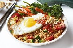 This vegetarian nasi goreng makes meat-free Mondays a little easier - and tastier. Vegetarian Fried Rice, Vegetarian Tacos, Vegetarian Recipes Dinner, Rice Dishes, Vegan Dishes, Easy Vegan Soup, Side Salad Recipes, Easy Family Meals, Family Recipes