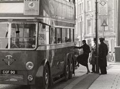 Boarding a new trolleybus at Crystal Palace, 1936.