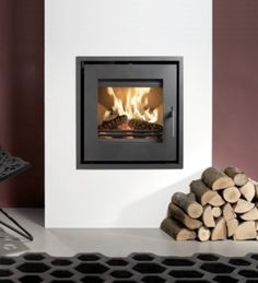 Wood-burning heating stove / built-in / contemporary UNIQ 23 Westfire ApS Inset Log Burners, Contemporary Wood Burning Stoves, Insert Stove, Wood Burning Fireplace Inserts, Into The Woods, Wood Burner, New Homes, Living Room, Living Area