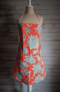 This handmade Women's Kitchen Apron is Coral with Teal and Gray Floral print. Accented with Teal, coral, orange, and gray wave print ties and neck strap. Made with high quality durable cotton fabric. Has long ties and two front pockets.  If you're looking for a great gift idea for Mother's Day, Birthdays, Anniversaries, Weddings, and Bridal Showers, this apron would be perfect! Who wouldn't want a beautiful yet functional apron?   One size fits most. ​Machine washable