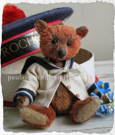 """Paula Strethill-Smith miniature teddy bear from antique mohair.Bernard is 3.5"""" high and created from antique mohair in faded bronze.I have further aged his fur and tinted with darker tones.He has a wobble neck joint and matt glass eyes and waxed nose. Bernard wears a vintage linen sailor jacket with vintage trim and tiny brass buttons. He sits inside a vintage French chocolate box in the shape of a sailor cap from La Rochelle."""