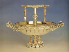 Menorah cleansing vessel.  The daily service of the Temple includes the cleaning of the seven oil cups of the Menorah, using the vessel pictured above, (in Hebrew, Hatavah). The vessel includes tongs and a brush.