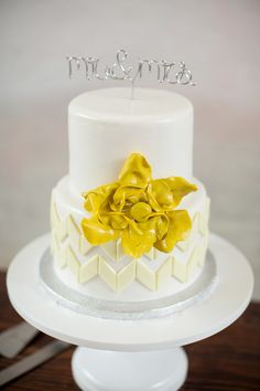 cake decoration wire instead of figures Photography: Theo Milo - theomilophotography.com  Read More: http://www.stylemepretty.com/2014/08/18/rustic-urban-garden-wedding/