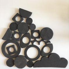 Arranging. #blackclay #graphic #pile #pattern #geometric #tiles