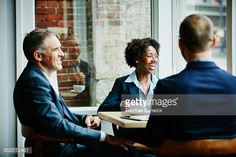 Stock Photo : Business colleagues laughing during meeting