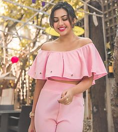 Reem Sameer posed in a cute pink frilly off-shoulder crop top, matching bell bottoms and silver heels. She went for a chic chignon and accesorised minimally with oversized silver hoop earrings. Child Actresses, Indian Actresses, Off Shoulder Crop Top, Hair Color For Black Hair, Girls Dpz, Budget Fashion, Indian Celebrities, Pink Fashion, Bell Bottoms