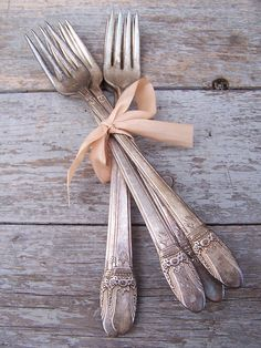 antique silver forks on wood silvered with exposure to the elements - lovely