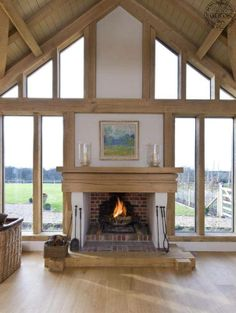 Inglenook fireplace in glazed oak frame gable, by Roderick James Architects Style At Home, Inglenook Fireplace, Fireplaces, Brick Fireplace, Fireplace Windows, Country Fireplace, Fireplace Kitchen, Fireplace Ideas, Oak Frame House