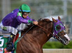 California Chrome with Victor Espinoza aboard wins the 2014 Kentucky Derby. Courtney V. Bearse