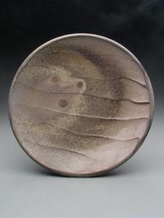 Patrick Rademaker, slip decorated and woodfired plate.  This was fired  in a Manabigama wood kiln.  There are lots of these kilns being built; Washington Redskin Chris Cooley also fires one for his pots.