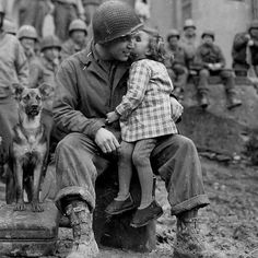 . From @historyphotographed . 9th Armored Division technician with a little French girl just after the Battle of the Bulge 1945.