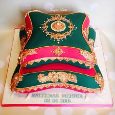 A large 2 tier pillow cake requested in fuschia pink & emerald green for the mehndi function of the lovely Saleena
