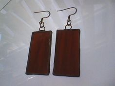 Stained glass earrings made of copper and red opalescent glass