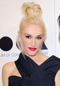 "FUN  BUN.Gwen's carefree updo is a nice juxtaposition against her strong makeup,"" says beauty editor Jessica Prince. ""To get a similar look create a ponytail set high on the crown of your head, twist and pin the tail and remove random pieces for a slightly undone finish."""